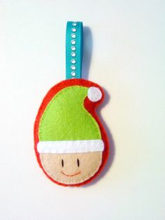 elf ornament- I'd swap red and green colors to look more like elf on shelf