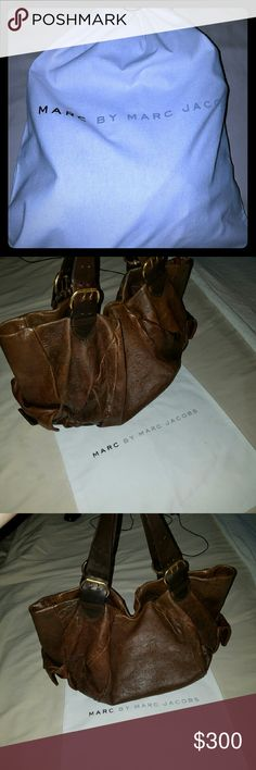 Marc by Marc Jacobs satchel & dust bag (**price drop till monday at noon theb back to $300**)Marc jacobs oversized Brown satchel with buckles hardware . Marc jacobs lettering detailing on outside and the inside of the bag looks like it has never been used . Pre-loved but in mint condition.  Comes with dust bag Marc by Marc Jacobs Bags Satchels