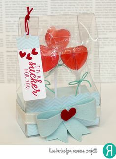 Gift package by Lisa Henke. Reverse Confetti stamp set: Sugary Sweet Sentiments. Confetti Cuts: In the Bag, Layered Bow, Heart Tag Toppers (heart). Valentine's Day gift. Lollipop holder.