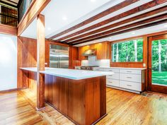 Wood and white kitchen with lots of space // Angelina Jolie's childhood home