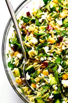 LOVE this HerbLovers Lemony Orzo Salad recipe Its filled with lots of fresh basil mint cucumber red onion chickpeas and feta Its naturally vegetarian and vegan if you nix. Orzo Salad Recipes, Pasta Recipes, Cooking Recipes, Healthy Recipes, Recipes Dinner, Arugula Salad Recipes, Healthy Pasta Salad, Cooking Kale, Cooking Pork