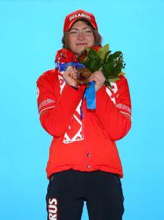 DAY 11:  Gold medalist Darya Domracheva of Belarus celebrates on the podium during the medal ceremony for the Women's 12.5 km Mass Start