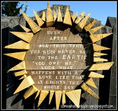 cool homemade sign - love the rustic sun rays!