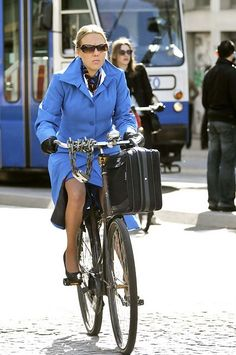 Dutch woman in style with KLM uniform.  I should trade my car in for a bike - much more environmentally-friendly commute!  lol