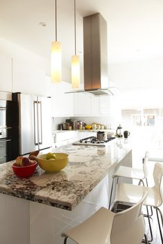 The Toronto kitchen of Véronique Claassen and Mathew Merrett with brown marble counter.
