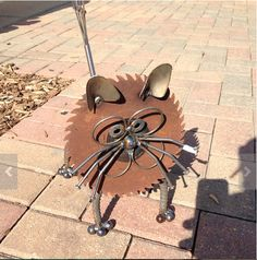 Cat made from recycled metal items.