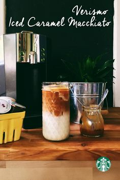 Starbucks Iced Caramel Macchiato Recipe using your Verismo: In a 12 oz glass add 2 tsp. vanilla syrup and 1 cup of ice. Brew 1 milk pod into the cup and swirl to cool the milk. Brew 1 espresso pod into the glass and top with caramel sauce :)