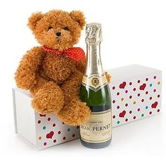 Cuddles & Bubbles   Send your love to friends and family with our gorgeous Cuddles and Bubbles gift. Presented in an attractive multi-coloured heart-adorned gift box we have partnered the very dapper Channel-Island born Cuddles the Bear with a half bottle of Grand Cru Champagne to create a really lovely gift choice.