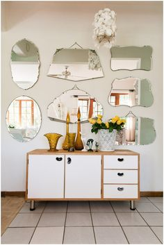 I actually have a wall of mirrors like this in my living room - it started with one and kinda just grew.  This type of mirror is easy to collect in charity shops and they looks so pretty in a big group.