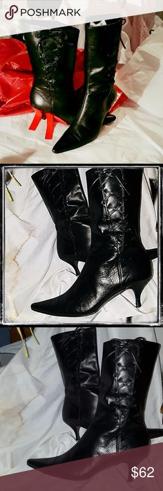 """black banana republic leather mid calf boots Sz 7 banana republic size 7  leather perfect condition boots they have faux lace up tasteful detailing  on the out side with a full zipper closure it has a 2 inch kitten heel ..and from th top of heel the boot night measures 9 """".... per inside not a scratch on them they're shiny but not Patten leather because bottoms  are leather too they show they been worn ..but not used. they were a gift just don't  fit  me Banana Republic Shoes Heeled Boots"""