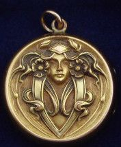 Antique Art Nouveau Repousse Gold Picture Locket Lady by S Lederer & Co.: Founded in Providence, Rhode Island in 1878. Later operated from Fifth Avenue in New York City. Ceased operations circa 1931. Produced gold plated and silver jewelry of good quality.