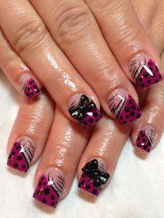Gel nails. Burgundy spots.