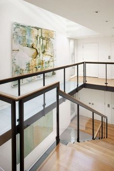 Modern four-storey urban home design wooden and glass stairs