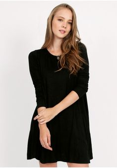 Black swing dress in soft fabric with round neckline, long sleeves and…