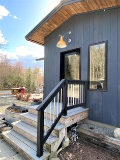 This exterior wall light, installed above a doorway, brings a bright splash of color to this outdoor space. Front Door Lighting, Exterior Lighting, Outdoor Lighting, Outdoor Decor, Modern Farmhouse Lighting, Curb Appeal, Light Colors, Vintage Designs, Beams