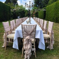 Vintage Nude Chiffon Ruffle Chair Hoods. Set-up by Ellis Events - creative chair cover hire and venue styling.