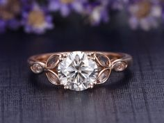 gemstone and diamond engagement ring in solid gold 14/18k white/yellow/rose gold available. Diamonds can be upgraded. Ring setting can be made. Ring can be resized. 30-Day Money Back guarantee.Customer Office in USA. Free Shipping to US. Jewelry Details: 6.5mm Round cut 1.0ctw Charles & Colvard Moissanite 6pcs marquise white topaz  Normally the ring needs 2-3 weeks to finish as it is handmade.Rush order available,you can ask me make your jewelry in rush if needed,it may take 7 business days…