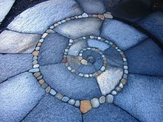 Flagstone paving with tiny spiral mosaic
