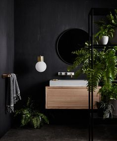 As far as bathroom paint colors go, black is hardly ever at the top of the list. This space, from Wood Melbourne, has us seriously reconsidering it. Outfitted with a mango wood vanity, lustrous brass…More Bathroom Interior, Home Interior, Interior Design, Modern Bathroom, Bathroom Black, Small Bathroom, Luxury Interior, Design Bathroom, Round Mirror In Bathroom
