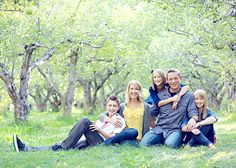 Family photo; sitting; natural background; varied heights & poses