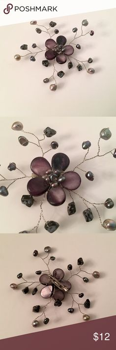 Handmade beaded flower pin with freshwater pearls Beautiful gray and purple-ish beads have been wired together to make this lovely pin. Perfect on a sweater or coat for added accessory. Accessories
