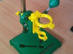 Rotary Tool Workstation - Homemade rotary tool workstation featuring a pivoting support. Constructed from 3D-printed parts, pipe, threaded rod, and hardware.