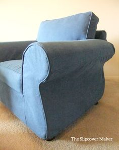 Scrolled arm chair fitted with indigo denim slipcover.