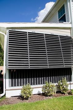I went on the hunt to find Bahama shutters that fit the bill. Have you ever priced Bahama shutters? These shutters needed to be 70 inches tall and span a gap of 141 inches wide which meant custom shutters and that bill came to Louvered Shutters, Custom Shutters, Wood Shutters, Window Shutters, House Shutters, Craftsman Exterior, Exterior Paint, Diy Exterior, Craftsman Style
