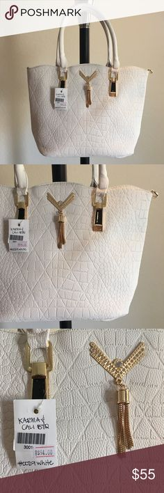 """👜 White Textured Tassel handbag / purse 🔥Brand New Boutique Item handbag (brand new with tags) ONLY 1 of this color and style available! By Karma & Cali Boutique 👜 -Color: white colored handbag with gold hardware, hanging tassel, and optional cross body strap -Dimensions: 15"""" length, 11"""" height, 5.5"""" width, 7.5"""" strap drop -Details: 2 interior pouches, 1 zippered pocket + bonus bag (free)  -Materials: soft animal friendly VEGAN LEATHER, easy to clean, creases iron out with use, *cannot be…"""