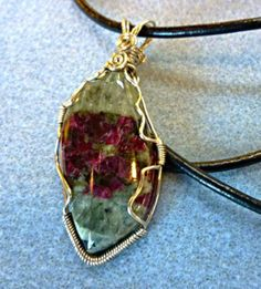 Pretty eudialyte wire wrapped pendant