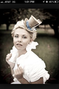 I want to wear a hat like this one at my wedding reception!  Lol.