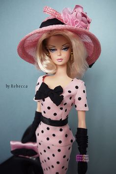 This reminds me of a dress I had.  It was this color of pink with large chocolate polka dots on it and layers of ruffles out of the material.  I had a special picture taken of me in it.  LOL.