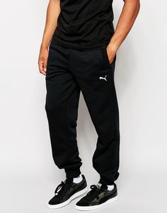 "Joggers by Puma Fleece-back sweat Drawstring waistband Side slant pockets Embroidered logo Elasticated cuffs Tapered fit Machine wash 70% Cotton, 30% Polyester Our model wears a size Medium and is 185.5cm/6'1"" tall"