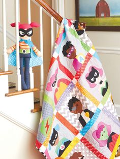 """Bedtime Superheroes quilt: This cute superheroes quilt for kids is featured in the book """"Happy Quilts!"""" by Antonie Alexander."""