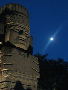 This lucky shot of Mayan statue with the moon was taken beneath the Tower of the Americas in San Antonio, Texas.