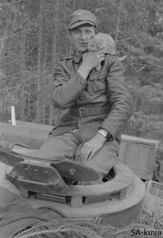 Finnish tank crew member with kitten