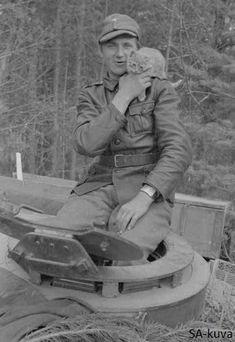 Finnish Stug member with cat mascot, 1944.