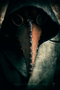 its a doctors mask used when there was the plague in england doctors thought that the black plague was contagious through the air so they packed the beak with sage or rosemary to stop the plague