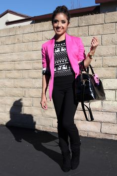 Hot pink blazer, cat sweater, black skinnies, black boots, and black bag.