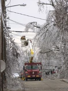 2007 ICE STORM ARCHIVE  =       A utility crew from PAR Electric in Kansas City works to restore power at Madison and Douglas St., Springfield,MO