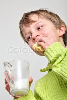 two 5 year old kids eating and drinking milk!