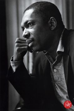 """John Coltrane John William Coltrane, also known as """"Trane"""" (September 23, 1926 – July 17, 1967), was an American jazz saxophonist and composer. Working in the bebop and hard bop idioms early in his career, Coltrane helped pioneer the use of modes in jazz and was later at the forefront of free jazz. He organized at least fifty recording sessions as a leader during his career, and appeared as a sideman on many other albums, notably with trumpeter Miles Davis and pianist Thelonious Monk."""