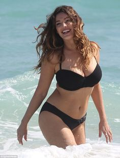 Making a splash: Kelly Brook frolics in the ocean during her latest swimwear campaign for New Look