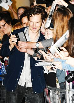 Cuteness: Benedict Cumberbatch seen signing autographs and taking selfies with fans outside the Barbican theatre stage door after his performance in Hamlet on August 12, 2015 in London, UK. (