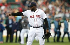 BOSTON - April 20, 2014: David Ortiz #34 of the Boston Red Sox gestures during the 2013 Boston Marathon bombing ceremony at Fenway Park before the game against the Orioles,.