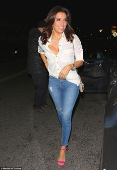 She's beaming: The 39-year-old star flashed a megawatt smile and some cleavage too...