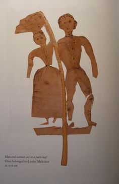 Man and a woman cut in a palm leaf