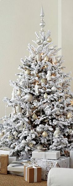 Christmas Tree Decorating Ideas-- someday I'll try a flocked christmas tree