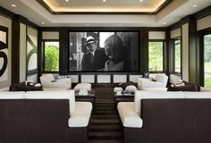 Home theater upstairs with automatic closing shades