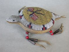 Reserved: Sioux Beaded Umbilical Cord Turtle Fetish American Flags